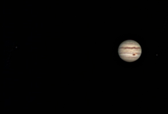 Jupiter with moons Europa (left) and Io (right)